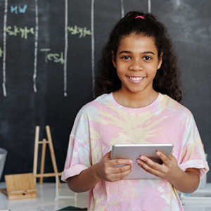 Child with Tablet in Classroom